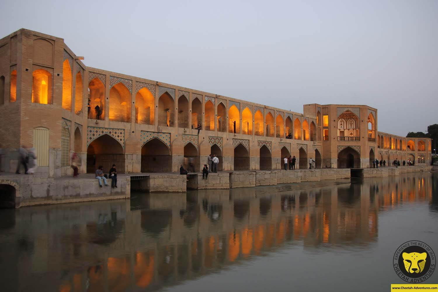 Iranian people chilling around Khaju Bridge, Zayandeh Rud River, Isfahan, Iran Tour