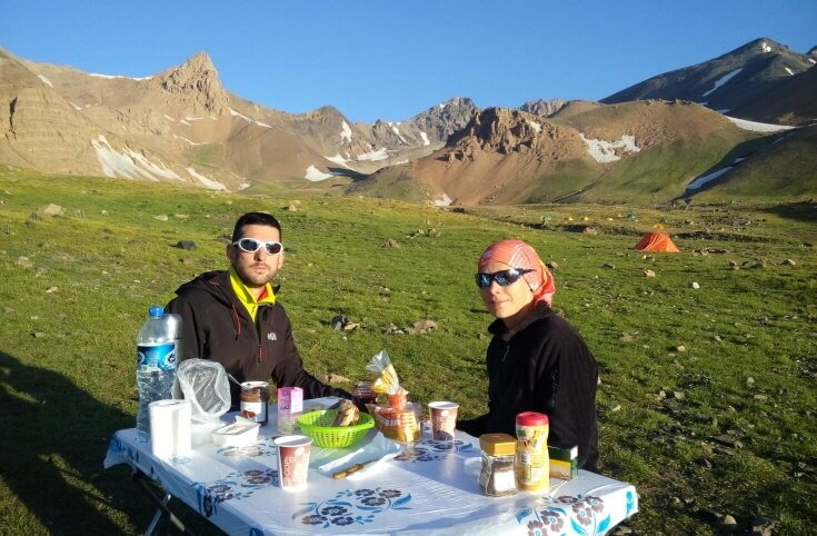 Having-breakfast-in-Hesarchal-Camp-3800m-Alamkuh-South-Face mount alamkuh trekking tour package