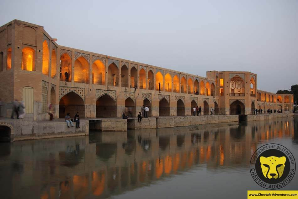 Iranian people chilling around Khaju Bridge, Zayandeh Rud River, Isfahan, Iran Tour