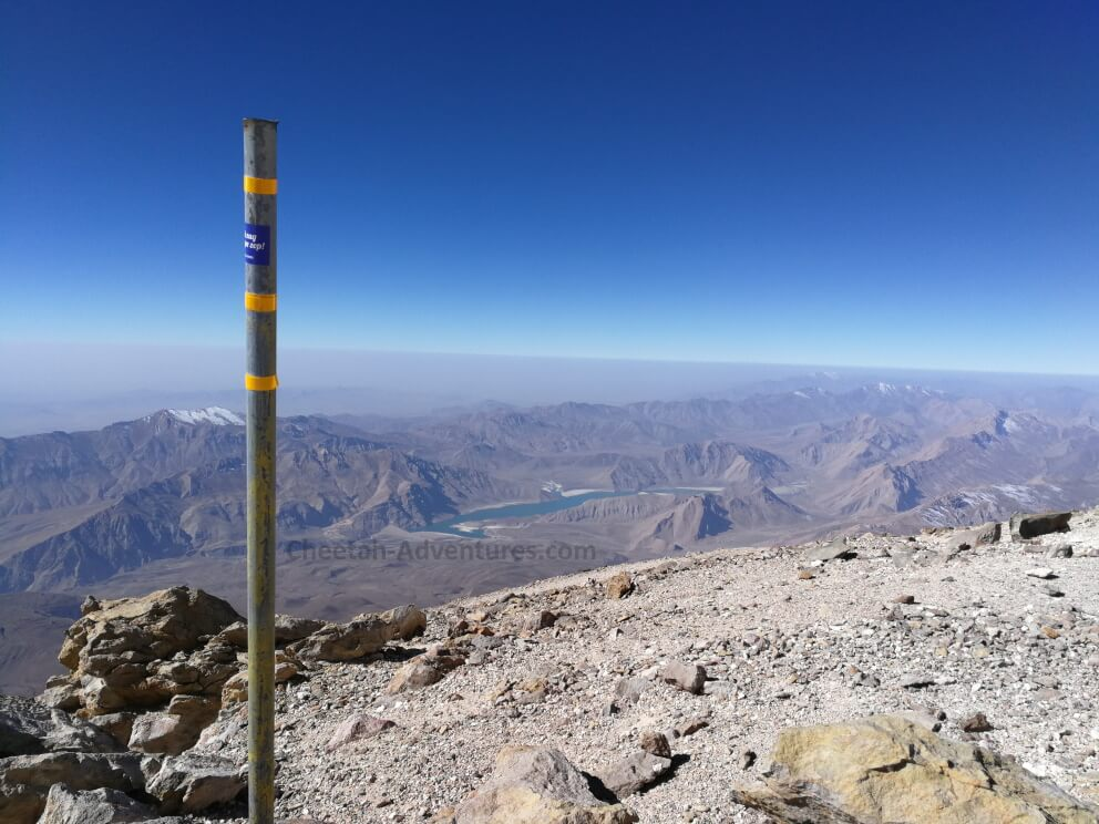 On the top of the Damavand fake summit, beginning of the sulfur hill at 5350m, Lar Lake at the background