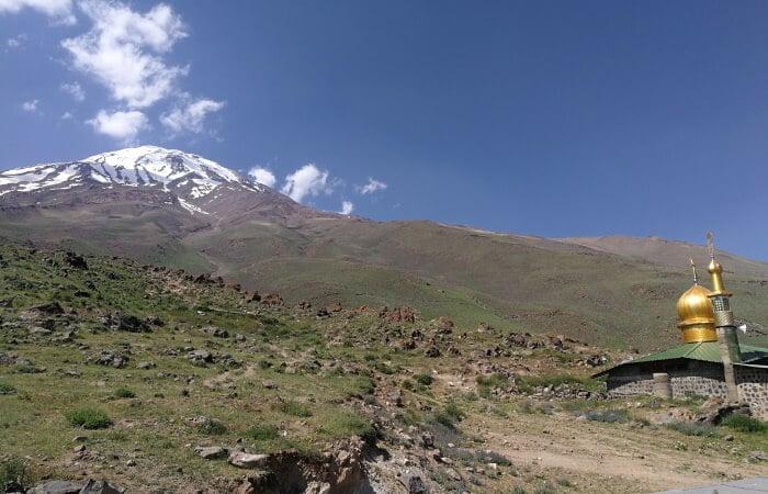 Mount Damavand mountain tour Damavand facts information Damavand and the Mosque from Goosfandsara basecamp (3000m)